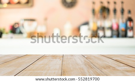 wood table with coffee cafe blur background