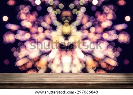 Wood table with colorful fireworks.bokeh blur - stock photo