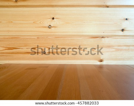 Wood table with wooden wall background