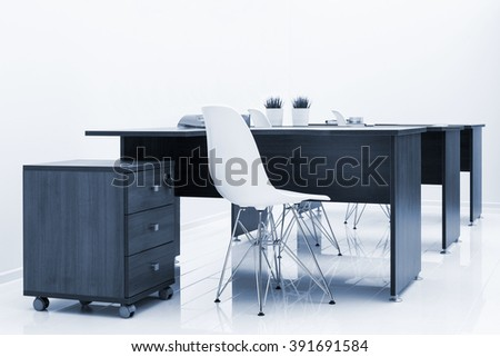 wood tables and white plastic chairs in the office - stock photo