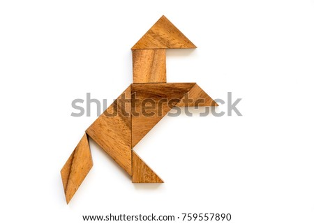 wood tangram puzzle in horse shape on white background