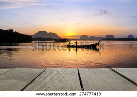 wood terrace and Beautiful sunrise in morning time use as natural background,backdrop - stock photo