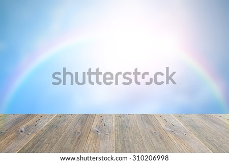 Wood terrace and blurred Blue sky and white cloud with rainbow - stock photo