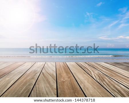 wood terrace on the beach and sun light - stock photo