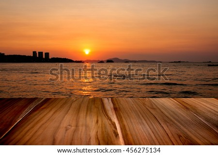 Wood terrace perspective with sun set twilight seascape - stock photo