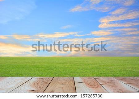 Wood terrace prairie and sky. - stock photo