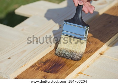 Wood texture and paintbrush. Housework background.