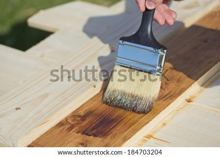 Wood texture and paintbrush. Housework background. - stock photo