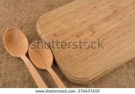 Wood texture background. Cutlery on tablecloth burlap sacking. Wooden table close up view from top. Wooden kitchen cutting board retro. Product pages for installation recipe books menu - stock photo