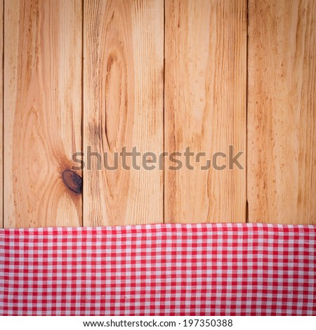 Wood texture background. Wooden table with red tablecloth white peas for recording menu, recipe. Product pages for installation recipe books menu  - stock photo
