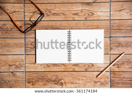 Wood texture mock up with notebook,  glasses and pencil. View from above.Create a card. - stock photo
