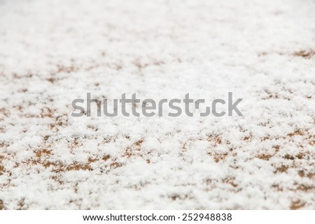Wood texture with snow background, selective focus, shallow dof - stock photo