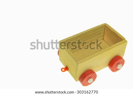 Wood toy carriage on white background.