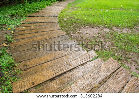wood trail in the garden - stock photo