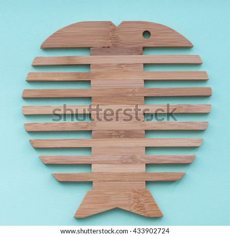 Wood Tray, Woodcraft Round Serving Tray with fish shape design. - stock photo