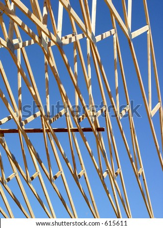 wood trusses against sky