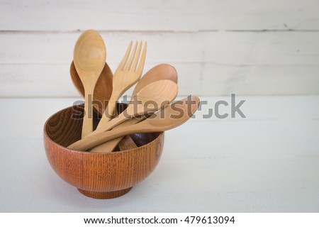 Wood utensils on wood table background. fork and spoon