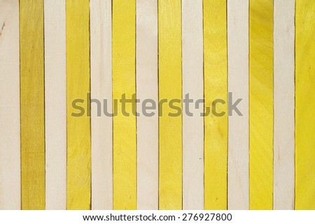 Wood vertical separated on purple and yellow color abstract background  - stock photo