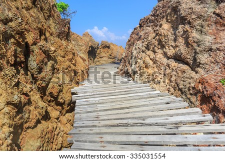 wood walk way over the sea shore - stock photo