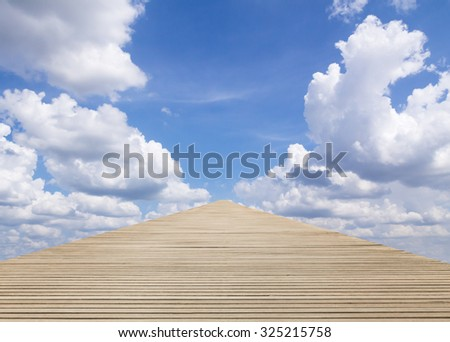Wood walkway to blue sky at under cloudy - stock photo