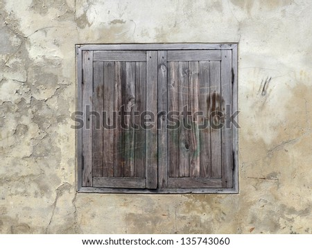 wood window on old wall background - stock photo
