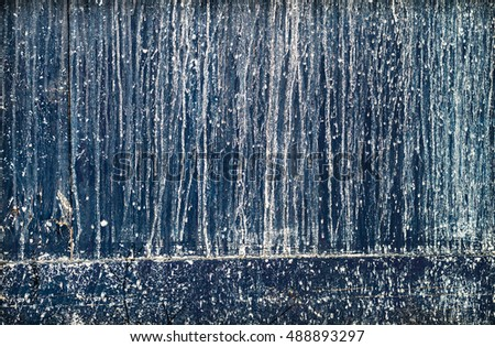 Wood with dripped whited paint background.