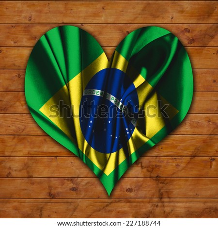 Wood with heart hole and vintage Brazil flag  - stock photo