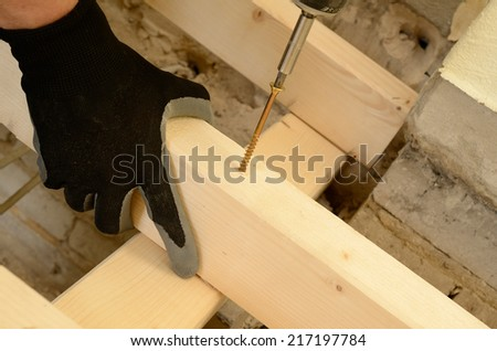 Wood worker is building a floor construction