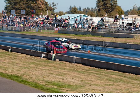 WOODBURN, OR - SEPTEMBER 27, 2015: Hart Braker funny car comes across the middle line during a semi-final race at the NHRA 30th Annual Fall Classic at the Woodburn Dragstrip.