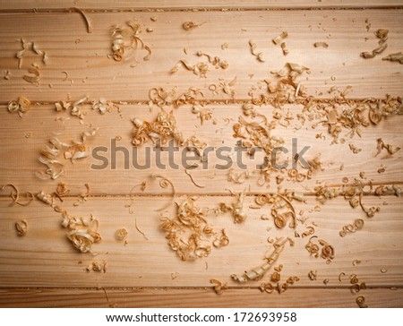 Woodchips (shavings) on wooden surface - stock photo