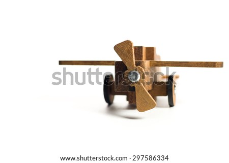 woodden plane focus on one point and  shallow depth of field  / wooden toy on white background