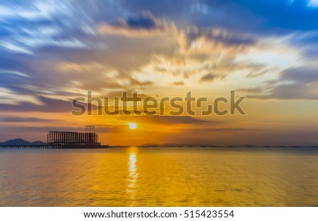 Wooded bridge in the port and sunset
