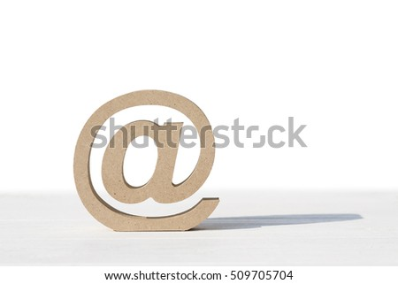 Wooded email symbol on white table, white background