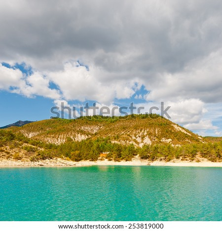Wooded Shore of the Lake in French Alps - stock photo