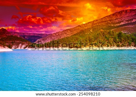 Wooded Shore of the Lake in French Alps, Sunset - stock photo