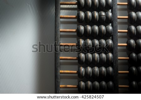Wooden abacus on table.