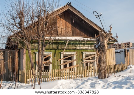 Wooden abandoned old house with the driven-in windows in Tyumen. Russia - stock photo