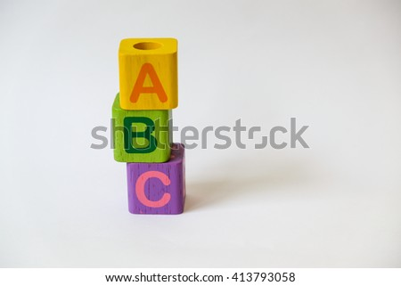 Wooden ABC Blocks on gray background with copyspace - stock photo