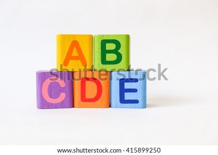 Wooden ABC Blocks on white background with copyspace - stock photo