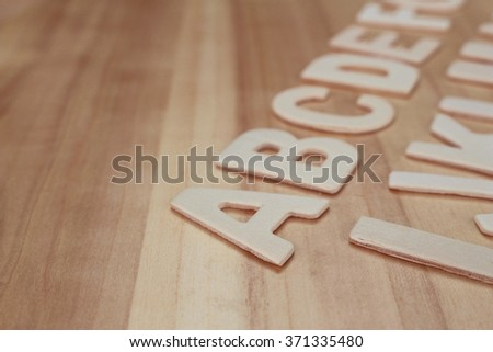 Wooden ABC letter alphabet on the wooden background - stock photo