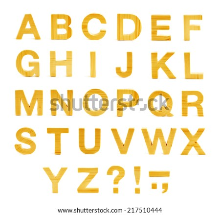 Wooden ABC letter alphabet set of latin letters and symbols made of yellow colored pine wood, isolated over the white background - stock photo