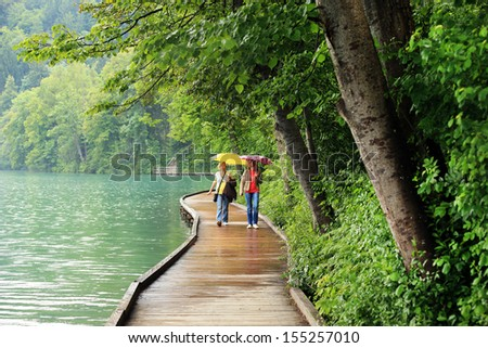 Wooden alley on Bled Lake, Slovenia, Europe - stock photo