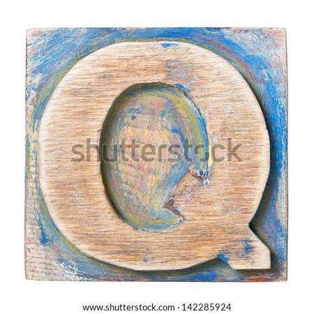 Wooden alphabet block, letter Q - stock photo