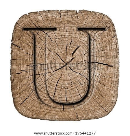 Wooden alphabet block,  letter U font Carved in wood, showing growth rings