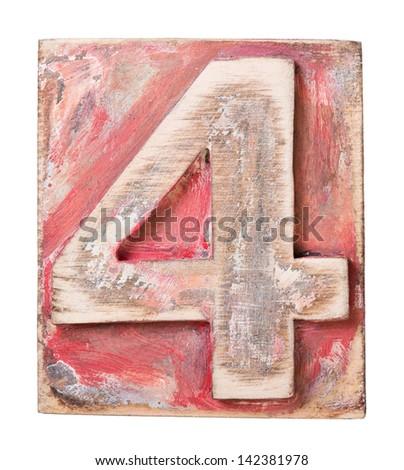 Wooden alphabet block, number 4 - stock photo