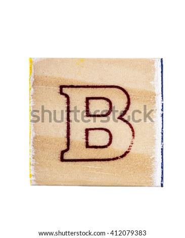 Wooden alphabet block with letter B isolated on white