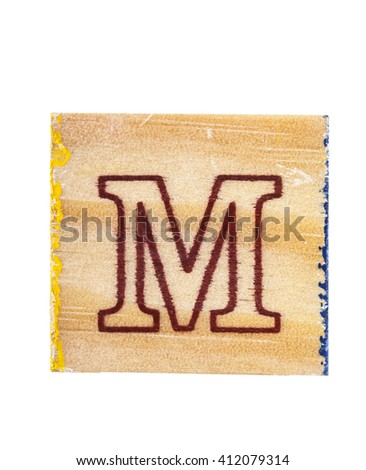 Wooden alphabet block with letter M isolated on white
