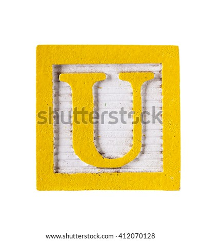Wooden alphabet block with letter U isolated on white