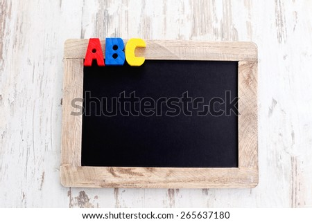 wooden alphabet blocks as a frame - education - stock photo