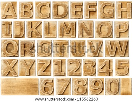 Wooden alphabet blocks with letters and numbers. - stock photo